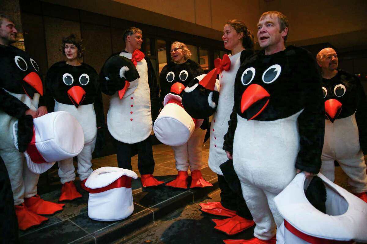 Penguins prepare to march during the Macy's Holiday Parade in Seattle on Friday, November 28, 2014. It rained on the parade but that didn't stop thousands of people from coming out the watch the annual event.