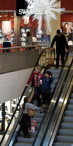 Shoppers take to the stores on Black Friday morning Nov. 28, 2014 at Crossgates Mall in Albany, N.Y.        (Skip Dickstein/Times Union) Photo: SKIP DICKSTEIN / 00029595A