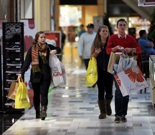 Early risers Jackie Larose, left, Megan Quinn and her brother Adam Quinn all of Londonderry, Vt., left home around 3 a.m. to do some shopping on Black Friday morning Nov. 28, 2014 at Crossgates Mall in Albany, N.Y.        (Skip Dickstein/Times Union) Photo: SKIP DICKSTEIN / 00029595A