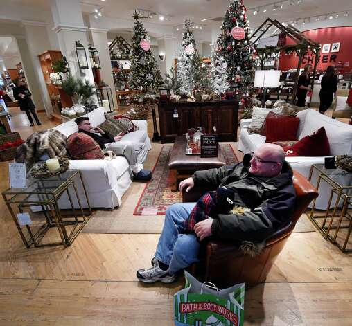 Jim Fake enjoys a comfy chair while his family does some shopping on Black Friday morning Nov. 28, 2014 at Crossgates Mall in Albany, N.Y.        (Skip Dickstein/Times Union) Photo: SKIP DICKSTEIN / 00029595A