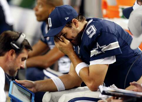 Dallas Cowboys quarterback Tony Romo (9) puts his hand to his face as he sits on the bench late during the second half of an NFL football game against the Philadelphia Eagles, Thursday, Nov. 27, 2014, in Arlington, Texas. Photo: John F. Rhodes / John F. Rhodes / Associated Press / FR170608 AP