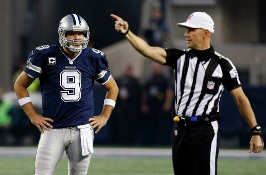 Dallas Cowboys' Tony Romo (9) looks to the sideline as an official gestures first down during the second half of an NFL football game against the Philadelphia Eagles, Thursday, Nov. 27, 2014, in Arlington, Texas. Photo: John F. Rhodes / John F. Rhodes / Associated Press / FR170608 AP