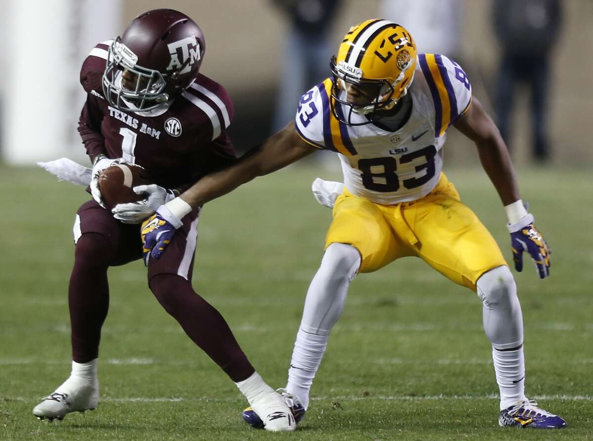 Texas A&M defensive back De'Vante Harris (1) intercepts a pass intended for LSU wide receiver Travin Dural (83) during the first quarter of an NCAA college football game at Kyle Field Thursday, Nov. 27, 2014, in College Station. ( Brett Coomer / Houston Chronicle )