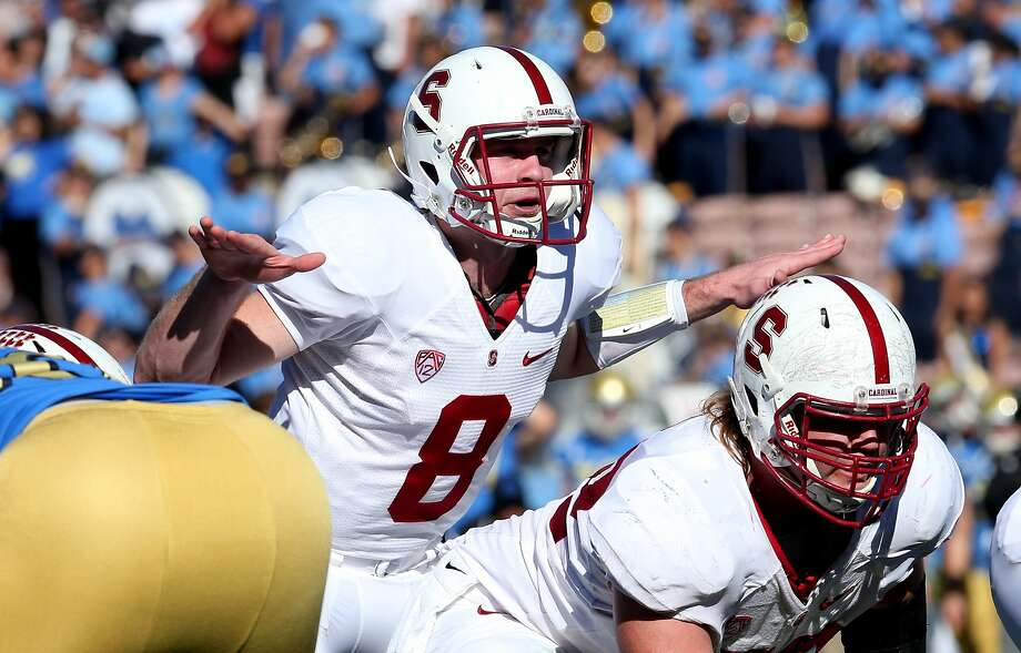 PASADENA, CA - NOVEMBER 28:  Quarterback Kevin Hogan #8 of the Stanford Cardinal signals at the line of scrimmage in the game against the UCLA Bruins at the Rose Bowl on November 28, 2014 in Pasadena, California.  (Photo by Stephen Dunn/Getty Images) Photo: Stephen Dunn, Getty Images