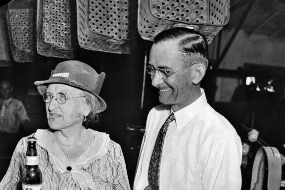 Emma Koehler, widow of San Antonio Brewery Association founder Otto Koehler, and brewery general manager B.B. McGimsey watch the first bottle of Pearl beer leave the vats after the repeal of Prohibition in 1933.