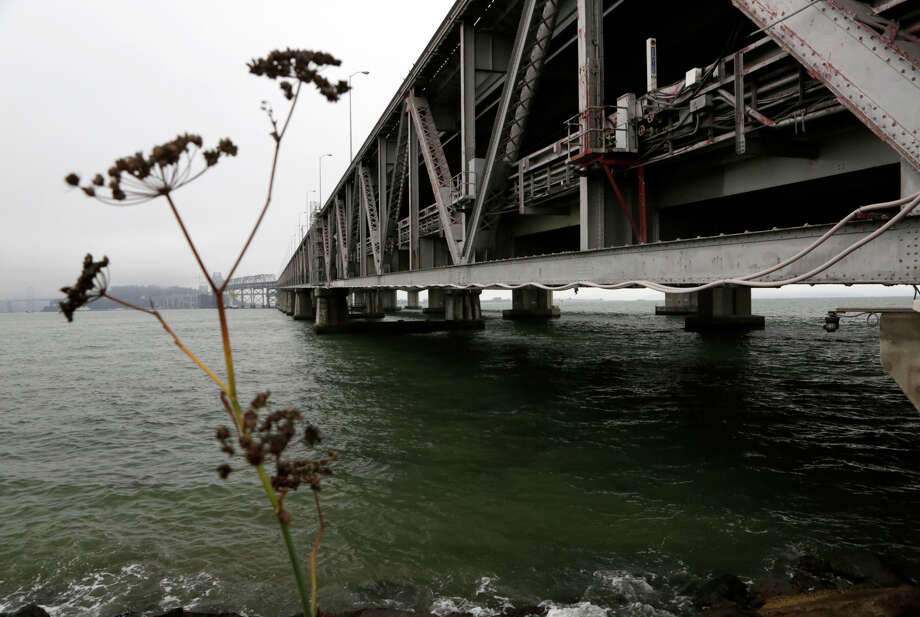 Weeds sprout from the construction zone at the eastern end of the old Bay Bridge in Oakland. Some concrete piers at the end of the old span may be left in place after most are demolished. Photo: Terray Sylvester / The Chronicle / ONLINE_YES