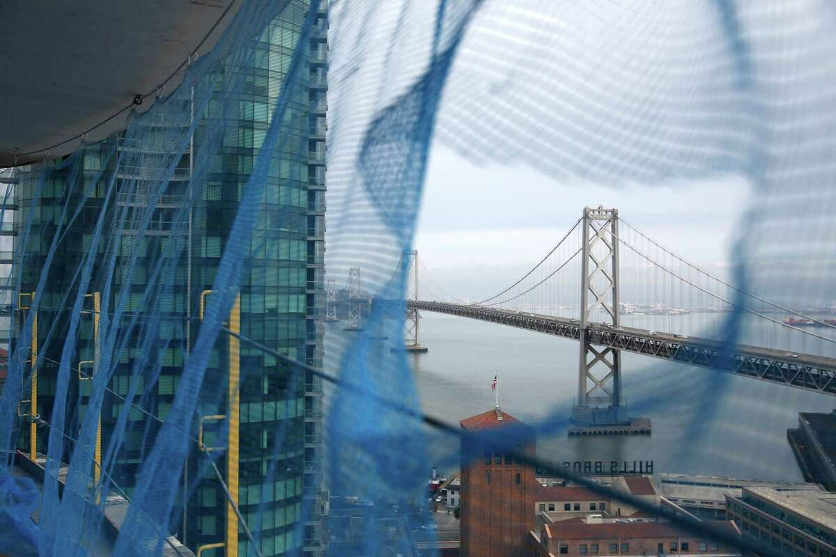 A view of the Bay Bridge is seen from netting from Lumina on Friday, November 21, 2014 in San Francisco, Calif.