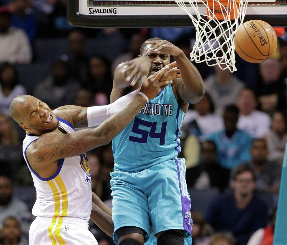 Marreese Speights (left) who scored 16 of his 27 points in the fourth quarter, is fouled by Charlotte's Jason Maxiell during the first half. Photo: Chuck Burton / Associated Press / AP