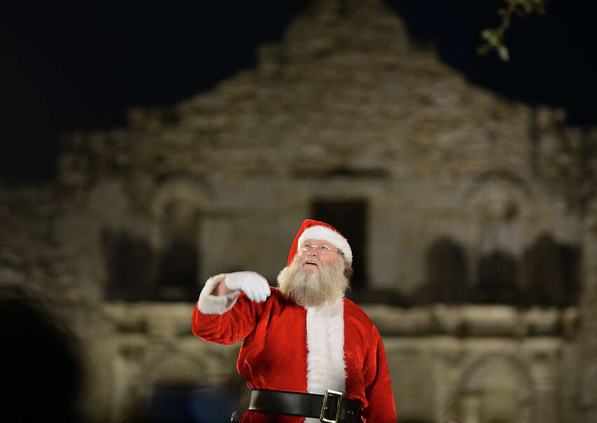 Santa Claus himself watches as the city's official Christmas tree is lit at the 30th Annual H-E-B Christmas Tree Lighting Celebration in Alamo Plaza on Friday, Nov. 28, 2014.