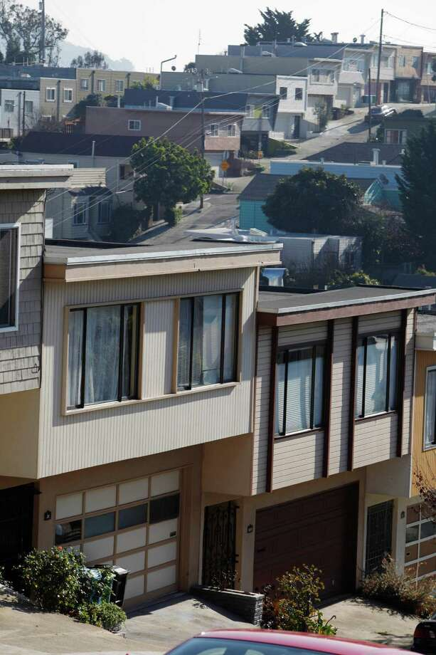 Row houses on Nebraska Street (foreground) are seen against row houses on Bradford Street (background) on Wednesday, November 26, 2014 in San Francisco, Calif. Photo: Lea Suzuki / The Chronicle / ONLINE_YES