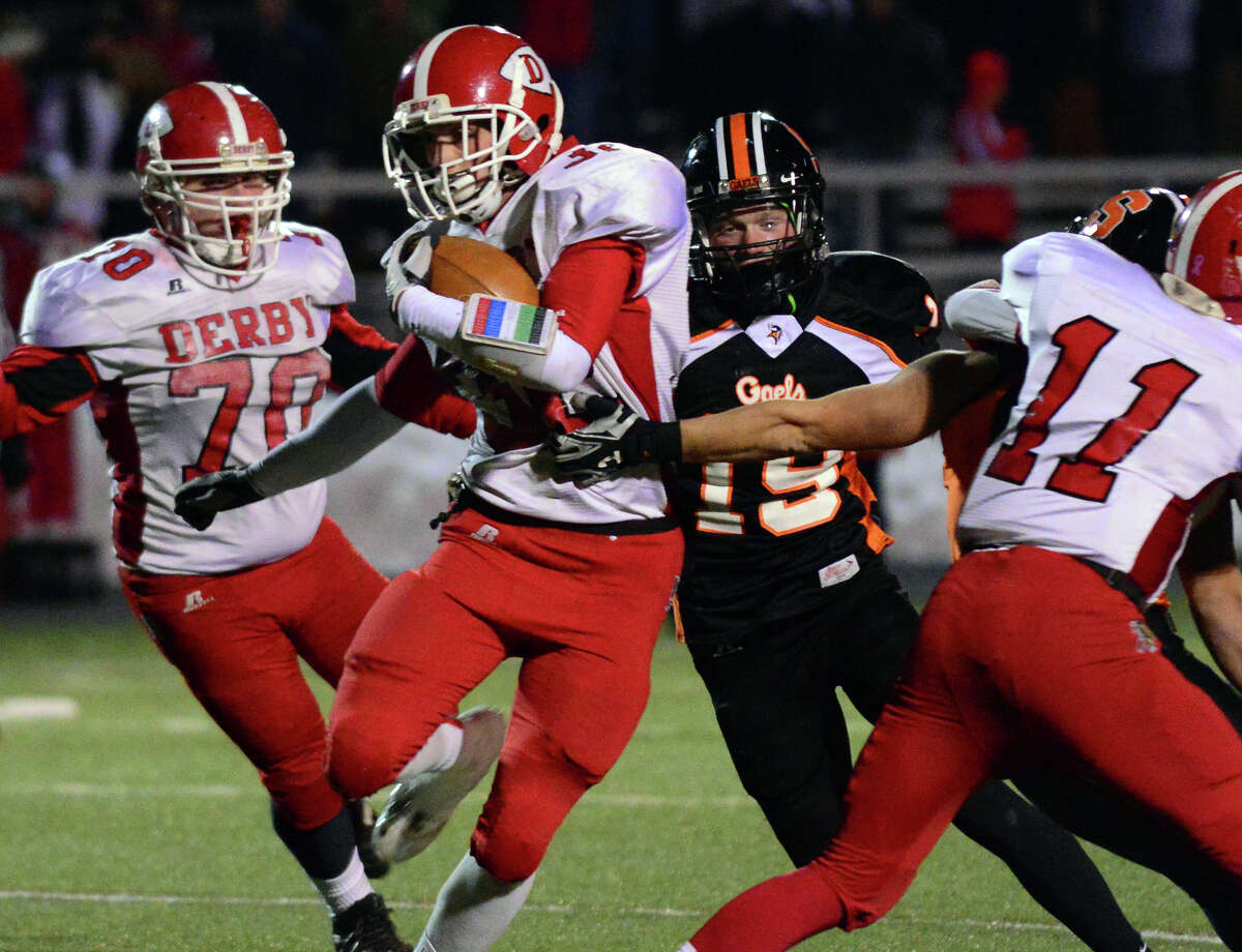 Thanksgiving holiday football action between Shelton and Derby in Shelton, Conn., on Friday Nov. 28, 2014.