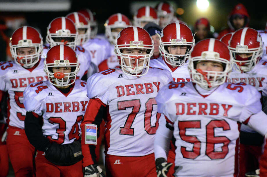 Thanksgiving holiday football action between Shelton and Derby in Shelton, Conn., on Friday Nov. 28, 2014. Photo: Christian Abraham / Connecticut Post