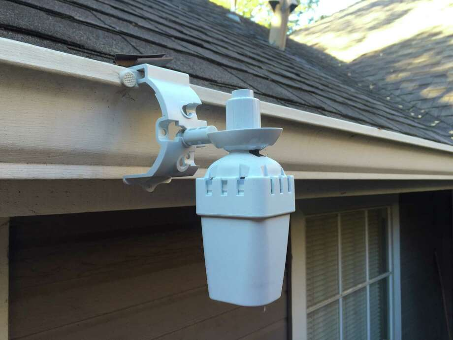 A rain sensor like this one mounted on a gutter is required by ordinance in San Antonio to prevent automatic sprinkler systems from turning on during or after a storm. Photo: Courtesy SAWS