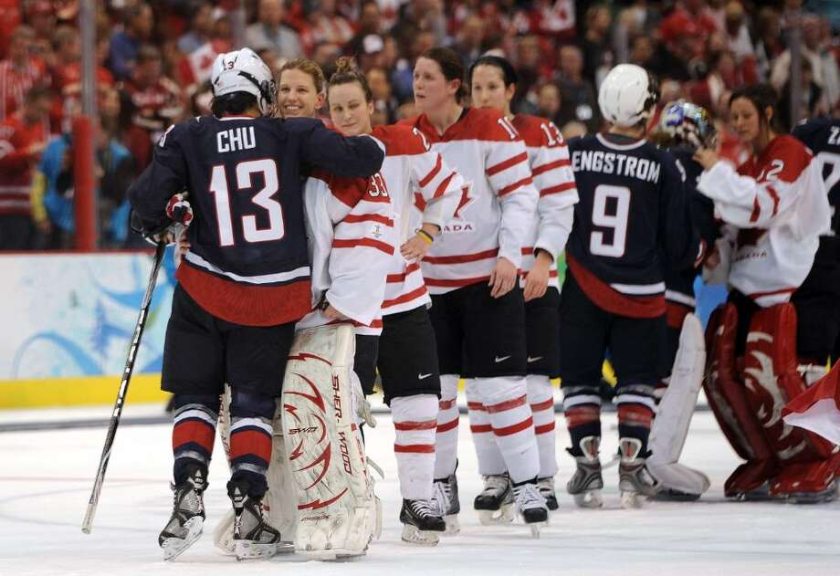 VANCOUVER, BC - FEBRUARY 25:  Kim St-Pierre #33 of Canada is hugged by Julie Chu #13 of USA following the ice hockey women's gold medal game between Canada and USA on day 14 of the Vancouver 2010 Winter Olympics at Canada Hockey Place on February 25, 2010 in Vancouver, Canada.  (Photo by Harry How/Getty Images) *** Local Caption *** Kim St-Pierre;Julie Chu Photo: Harry How, Getty Images / 2010 Getty Images