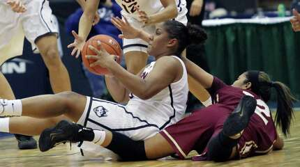 UConn's Kaleena Mosqueda-Lewis steals the ball from College of Charleston's Jackie Luna-Castro during an NCAA college women's basketball game Friday, Nov. 28, 2014 in Estero, Fla. (AP Photo/The News-Press, Jack Hardman)  MAGS OUT; NAPLES OUT;  NO SALES