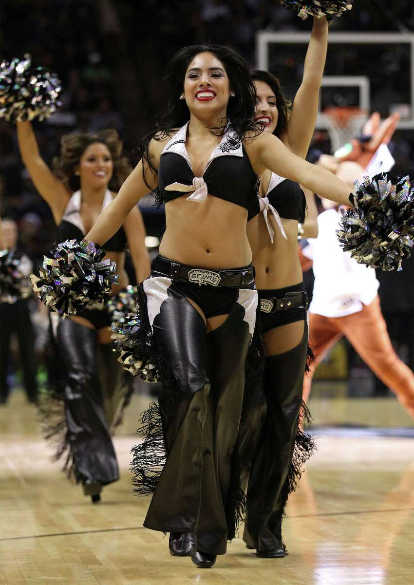 The Spurs' Silverdancers perform during a timeout in the game against the Sacramento Kings at the AT&T Center on Friday, Nov. 28, 2014. Spurs defeat the Kings 112-104. (Kin Man Hui/San Antonio Express-News)