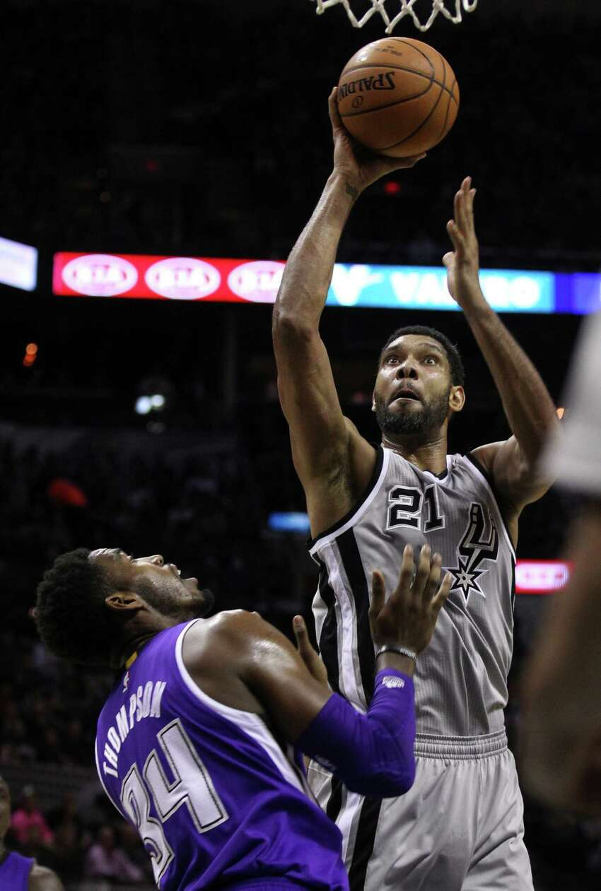 Spurs' Tim Duncan (21) shoots over Sacramento Kings' Jason Thompson (34) at the AT&T Center on Friday, Nov. 28, 2014. (Kin Man Hui/San Antonio Express-News)