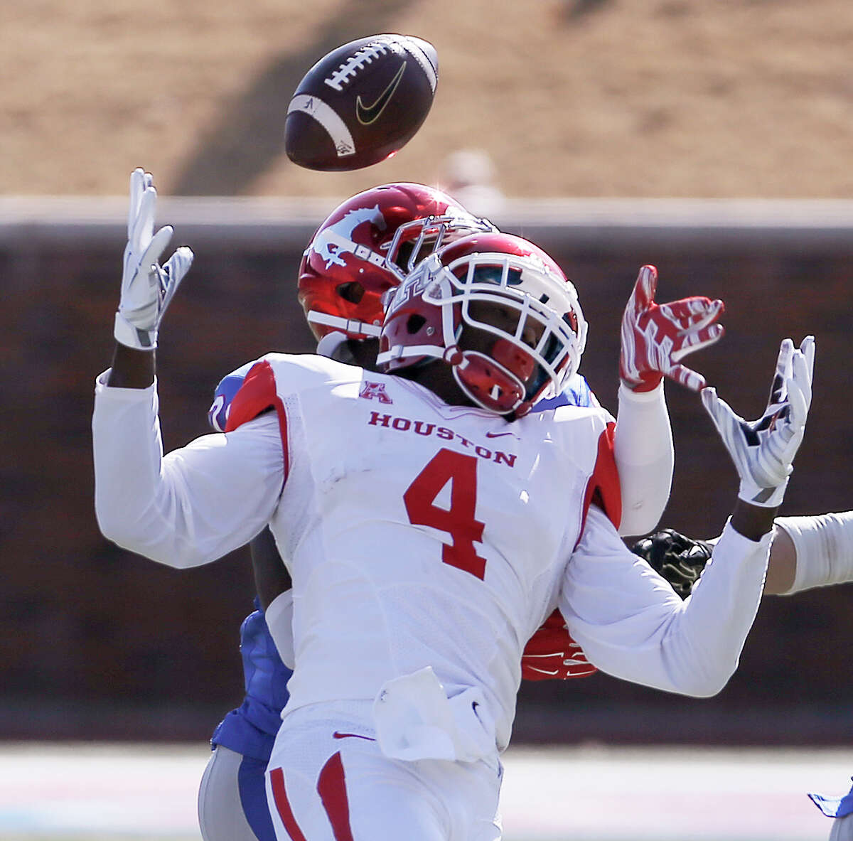 Houston wide receiver Daniel Spencer (4) is unable to catch a pass as SMU defensive back Darrion Richardson (29) defends during the first half of an NCAA college football game Friday, Nov. 28, 2014, in Dallas. (AP Photo/The Dallas Morning News, Brandon Wade) MANDATORY CREDIT; MAGAZINES OUT; TV OUT; INTERNET USE BY AP MEMBERS ONLY; NO SALES