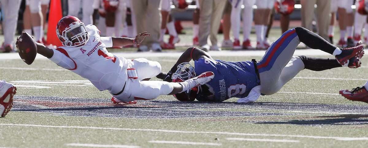 SMU defensive back Horace Richardson (9) tackles Houston quarterback Greg Ward Jr. (1) during the first half of an NCAA college football game Friday, Nov. 28, 2014, in Dallas. (AP Photo/The Dallas Morning News, Brandon Wade) MANDATORY CREDIT; MAGAZINES OUT; TV OUT; INTERNET USE BY AP MEMBERS ONLY; NO SALES