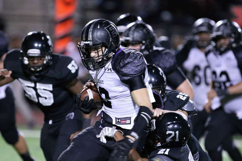 Weslaco East running back Lupe Moron rushes for a first down gain against Cibolo Steele at Buc Stadium in Corpus Christi, Texas on Friday, November 28, 2014. Photo: Micah DeBenedetto / Micah DeBenedetto / Micah DeBenedetto / San Antonio Express-News