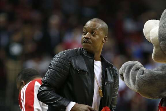 Former Houston Rockets player Steve Francis participates in the t-shirt toss during the second half of an NBA basketball game at Toyota Center, Friday, Nov. 28, 2014, in Houston.  ( Karen Warren / Houston Chronicle  )