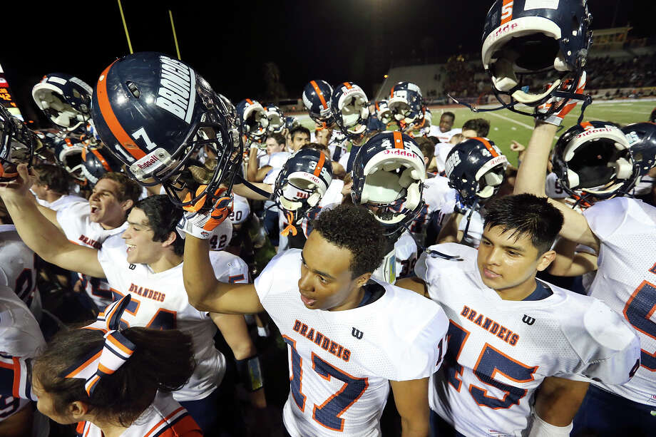 Members of the Brandeis Broncos football team celebrate their 42-14 win over the Brownsville Rivera Raiders in their Class 6A Division II third-round playoff game Friday Nov. 28, 2014 at Texas A&M Kingsville's Javelina Stadium in Kingsville. Photo: Edward A. Ornelas /San Antonio Express-News / © 2014 San Antonio Express-News