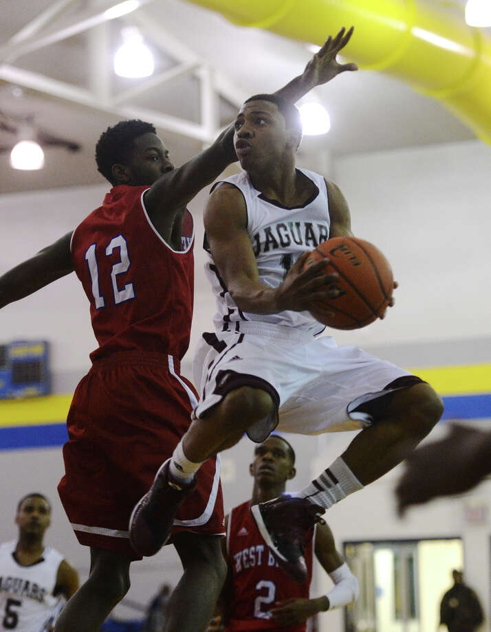 West Brook's Rodney Brown, No. 12, attempts to defend the basket from Central's Dominique Harrison, No. 10, during Friday's tournament game. The Fred Williams Classic basketball tournament was held at Ozen High School on Friday afternoon. Photo taken Friday 11/28/14 Jake Daniels/The Enterprise Photo: Jake Daniels / ©2014 The Beaumont Enterprise/Jake Daniels