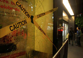 A broken window at Macy's Union Square is taped after a protest turned violent Friday night.