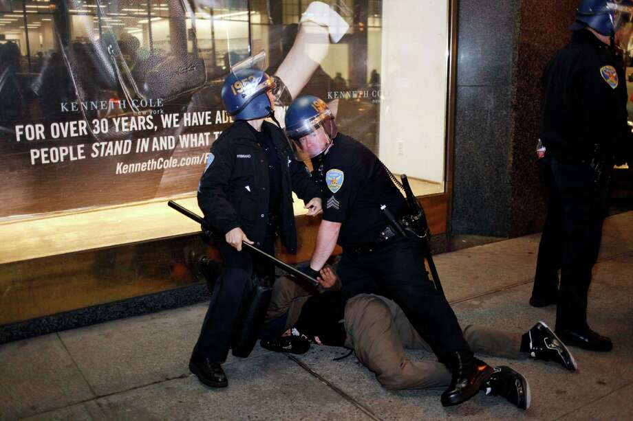 Police detain a man near 5th and Market during a march to call attention to the shooting of Michael Brown and Ferguson, MO on November 28, 2014 in San Francisco, Calif. Photo: Pete Kiehart / The Chronicle / ONLINE_YES