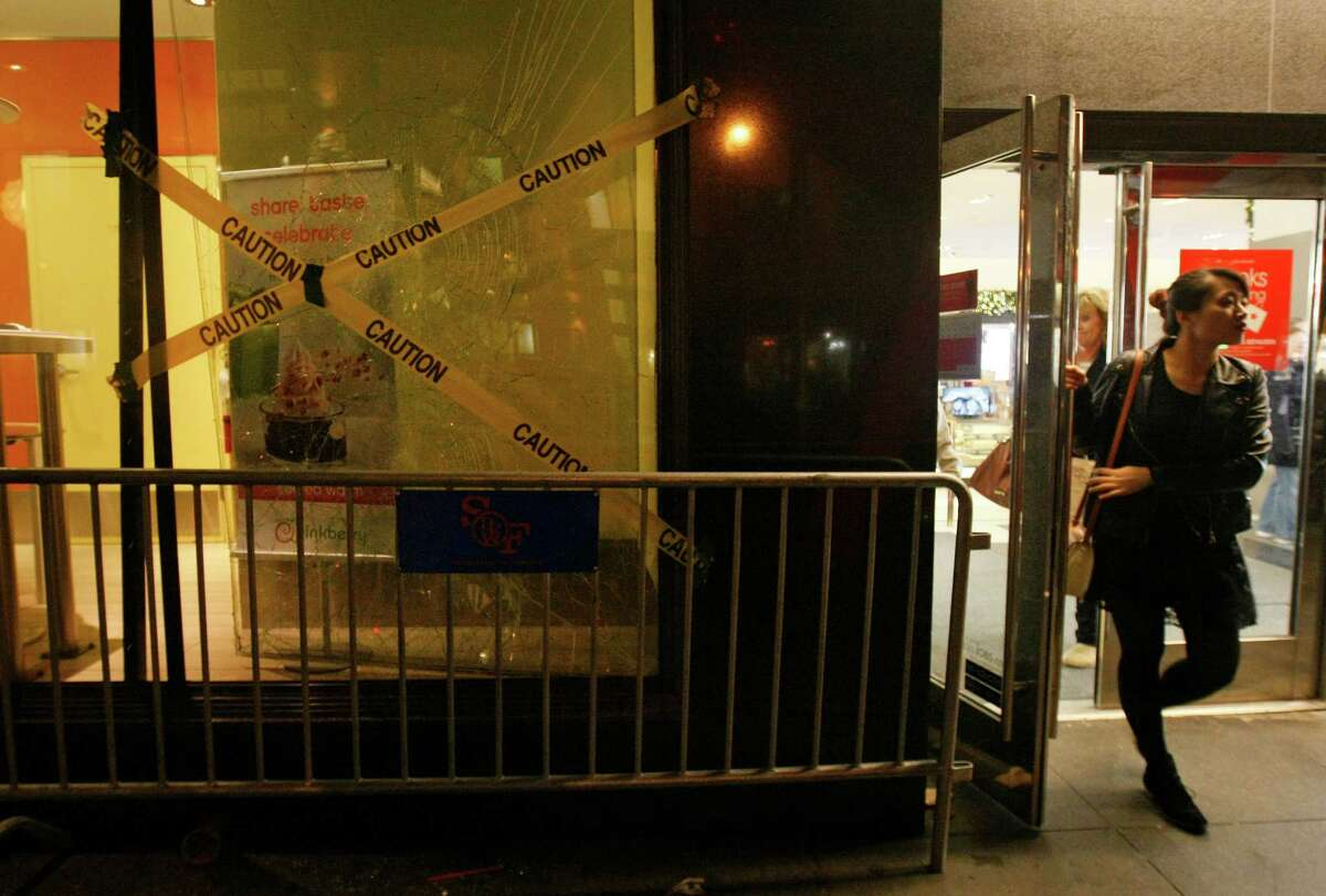 Caution tape covers the smashed window of a Macy's Store on O'Farrell Street following a protest in Union Square in San Francisco, Calif. Friday, November 28, 2014 shining light on the shooting of Michael Brown in Ferguson, Missouri.