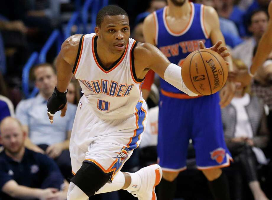 Oklahoma City Thunder guard Russell Westbrook heads upcourt with a steal in the third quarter of an NBA basketball game against the New York Knicks in Oklahoma City, Friday, Nov. 28, 2014. Oklahoma City won 105-78. (AP Photo/Sue Ogrocki) Photo: Sue Ogrocki / Associated Press / AP