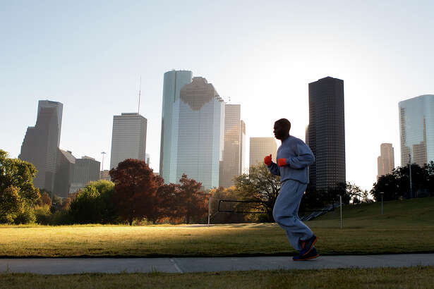 A man jogs through Eleanor Tinsley Park as the sun rises, Friday, Nov. 28, 2014, in Houston. The forecast for sunny weather with a high of 75 degrees for both Saturday and Sunday.