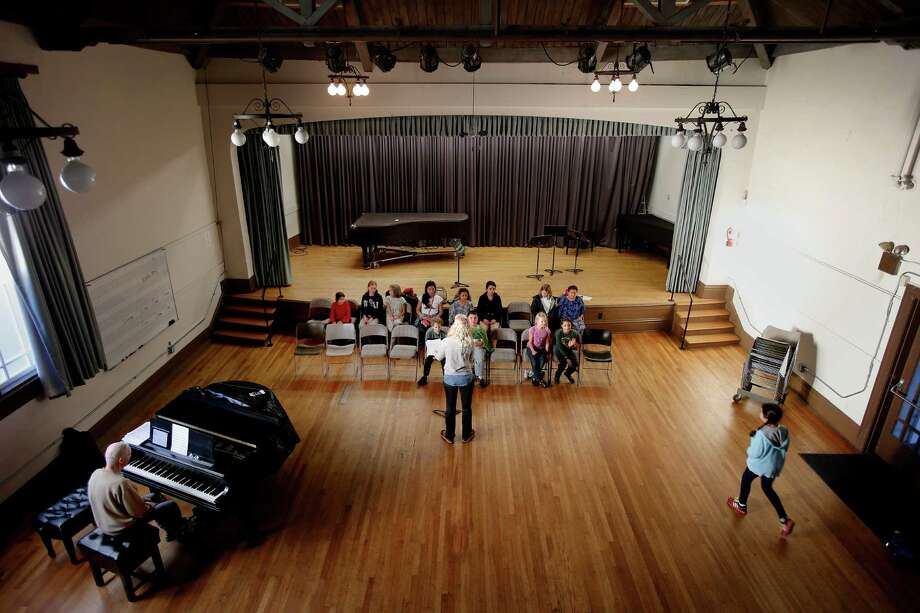 Children's chorus members use a large rehearsal room at the rear of the Community Music Center in San Francisco's Mission District.  offers musical opportunities to more than 2,400 people a year ranging in age from babies to students in their 90s. Photo: Brant Ward / The Chronicle / ONLINE_YES