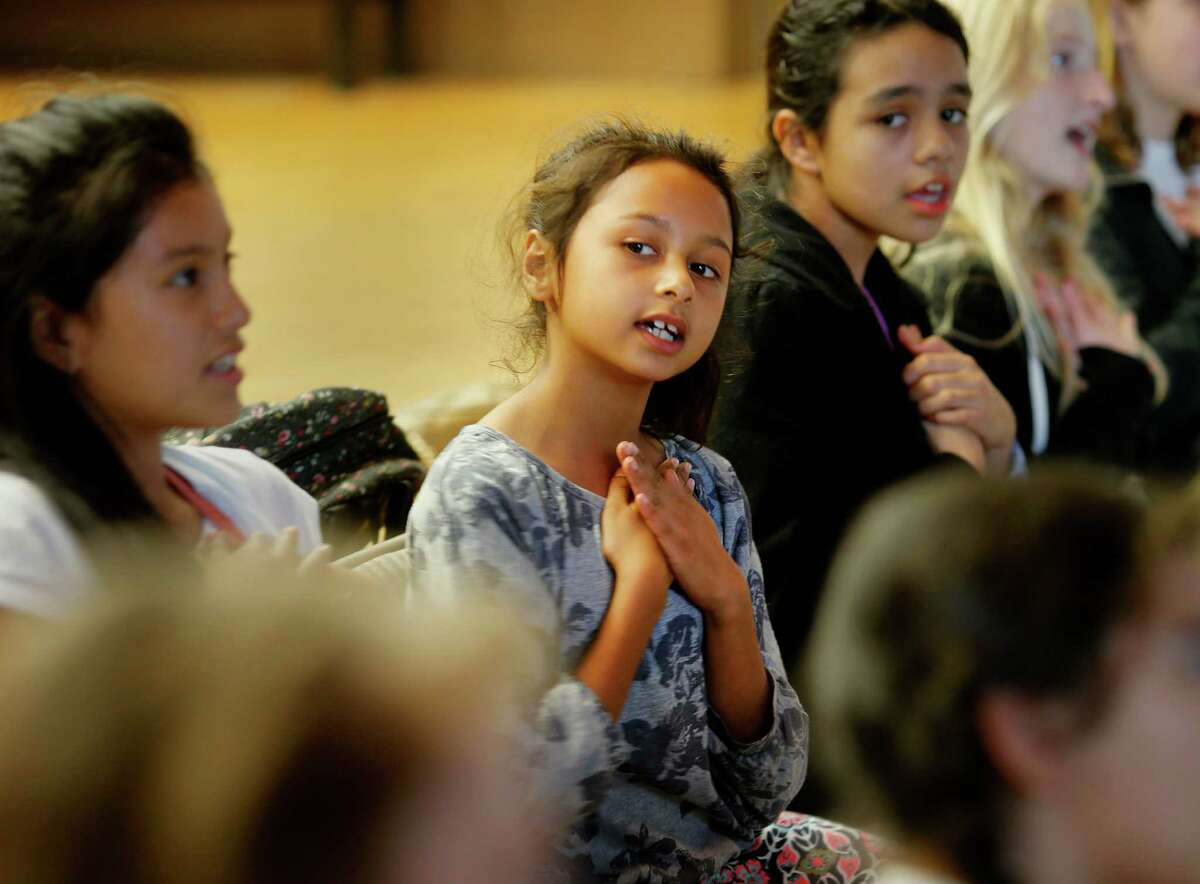 Lucinda Ayres (center), 8, and others also used their hands during choral rehearsal at the Music Center. The Community Music Center in San Francisco's Mission district offers musical opportunities to more than 2,400 people a year ranging in age from babies to students in their 90s.