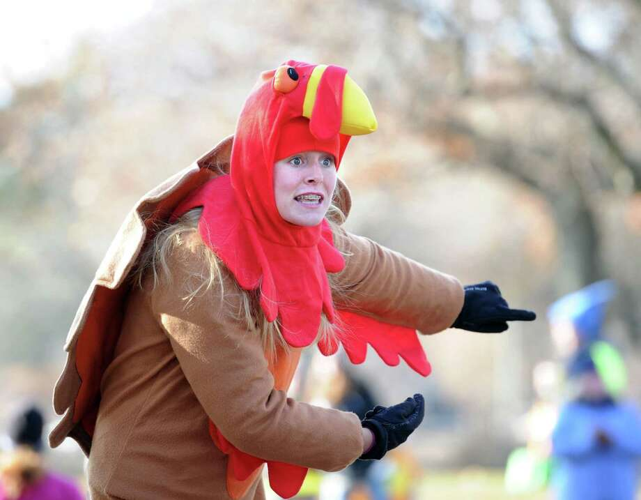 Kara Bittman, 14, of Greenwich, dressed as a turkey, directed runners to the finish-line during the Greenwich Alliance for Education annual Turkey Trot fundraising races at Roger Sherman Baldwin Park, Greenwich, Conn., Saturday morning, Nov. 29, 2014. Photo: Bob Luckey / Greenwich Time