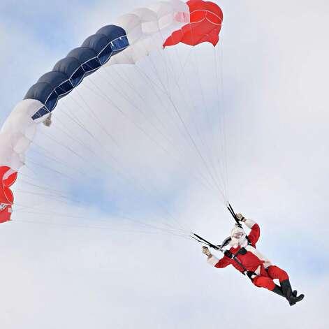 Santa Claus parachutes onto the EllmsO Christmas Tree Farm Saturday Nov. 29, 2014.  (John Carl D'Annibale / Times Union) Photo: John Carl D'Annibale / 00029634A