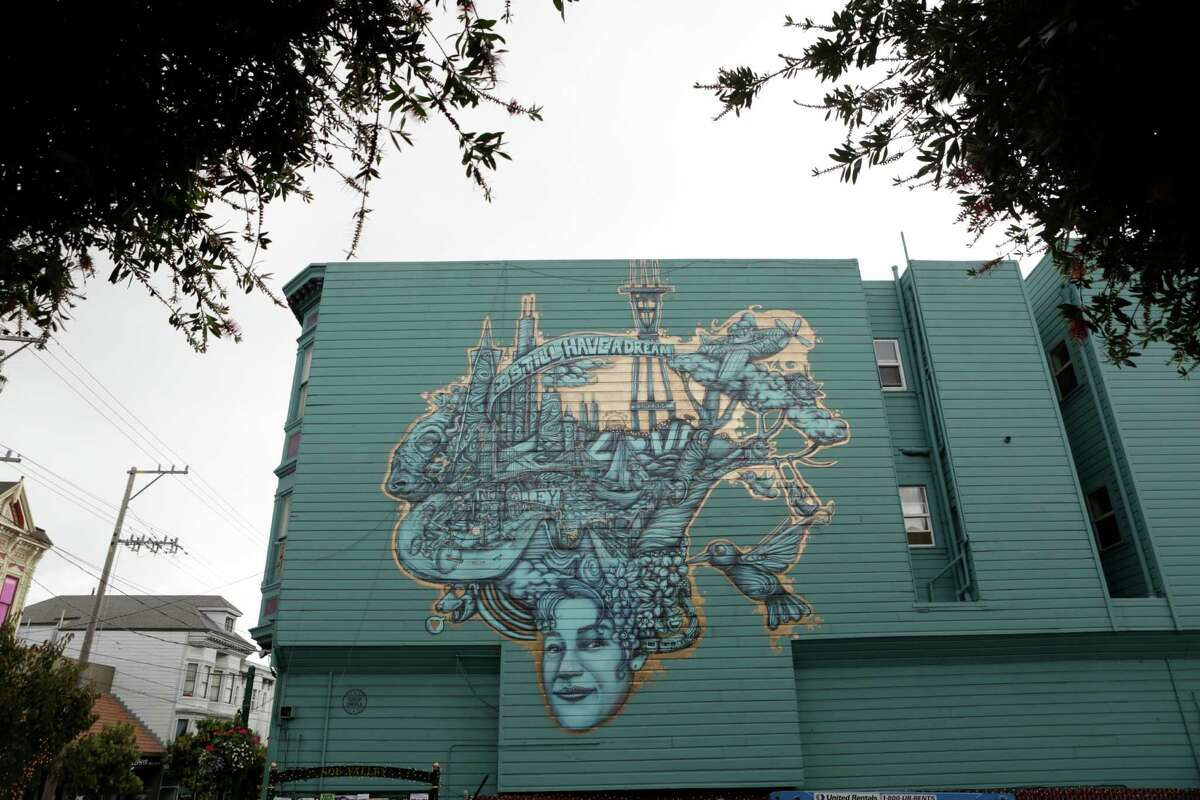 A mural, sponsored by American Express for Small Business Saturday, is seen on the side of a building on 24th Street in Noe Valley in San Francisco on Saturday, Nov. 29, 2014. The mural is not yet finished.