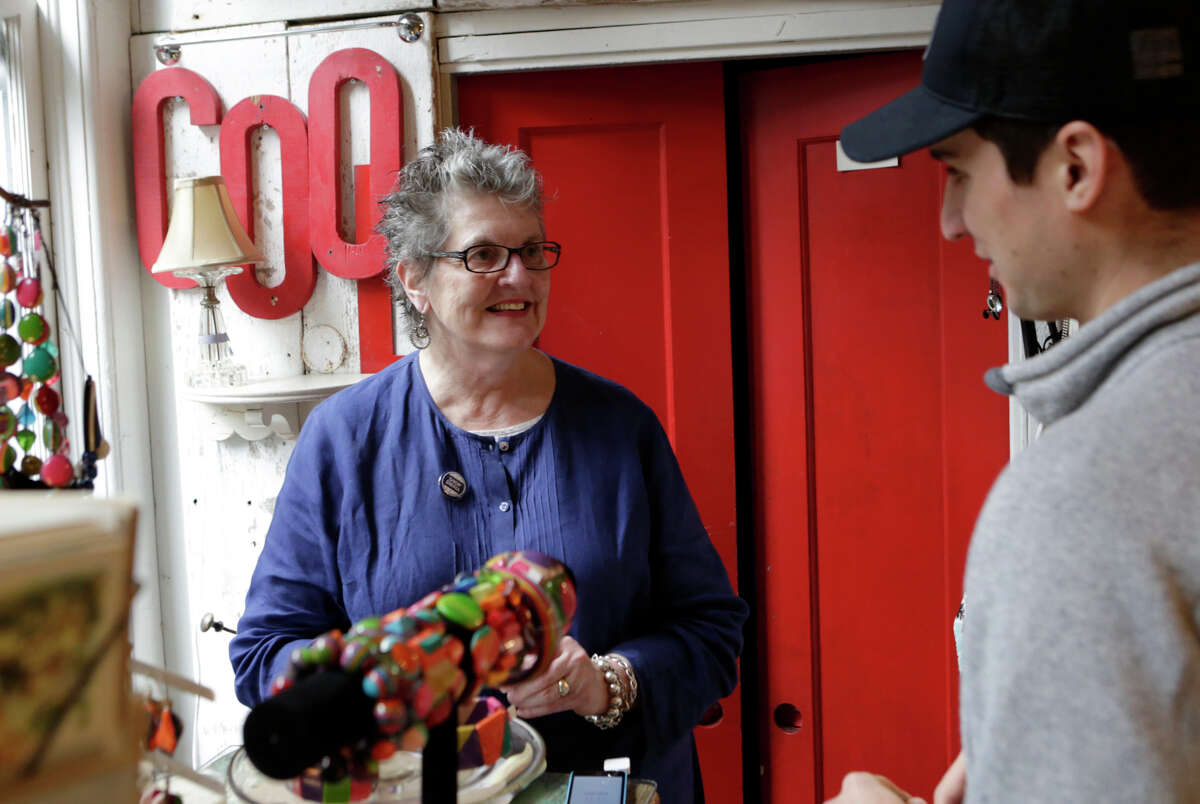 Joan O'Connor, owner of Timess Treasures, talks to Jeffrey Salvitti at the shop, which has space inside Zonal furniture store on Hayes Street in S.F. during Small Business Saturday.