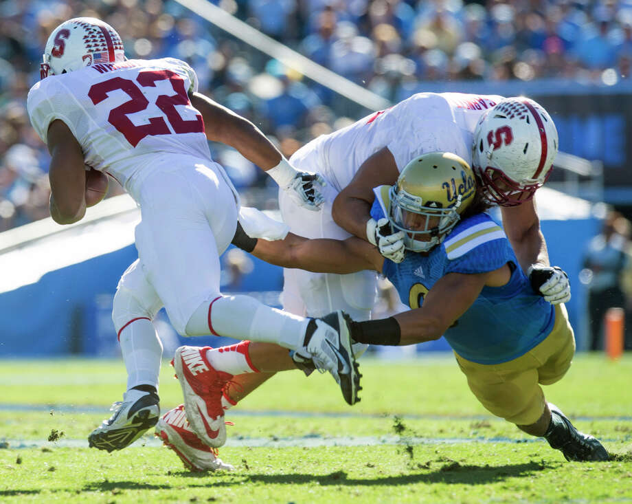 UCLA's linebacker Eric Kendricks (6) gets blocked away from Stanford's running back Remound Wright (22) during the first half of an NCAA college football game, Friday, Nov. 28, 2014, in Pasadena, Calif. Stanford won 31-10. (AP Pho to/The Orange County Register, Michael Goulding)   MAGS OUT; LOS ANGELES TIMES OUT Photo: Michael Goulding / Associated Press / The Orange County Register