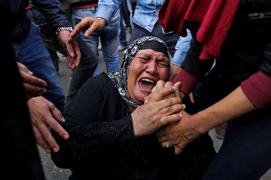 A woman cries during a protest after a judge dismissed the case against former President Hosni Mubarak in the killing of protesters during the 2011 uprising. Photo: Hussein Tallal / Associated Press / AP