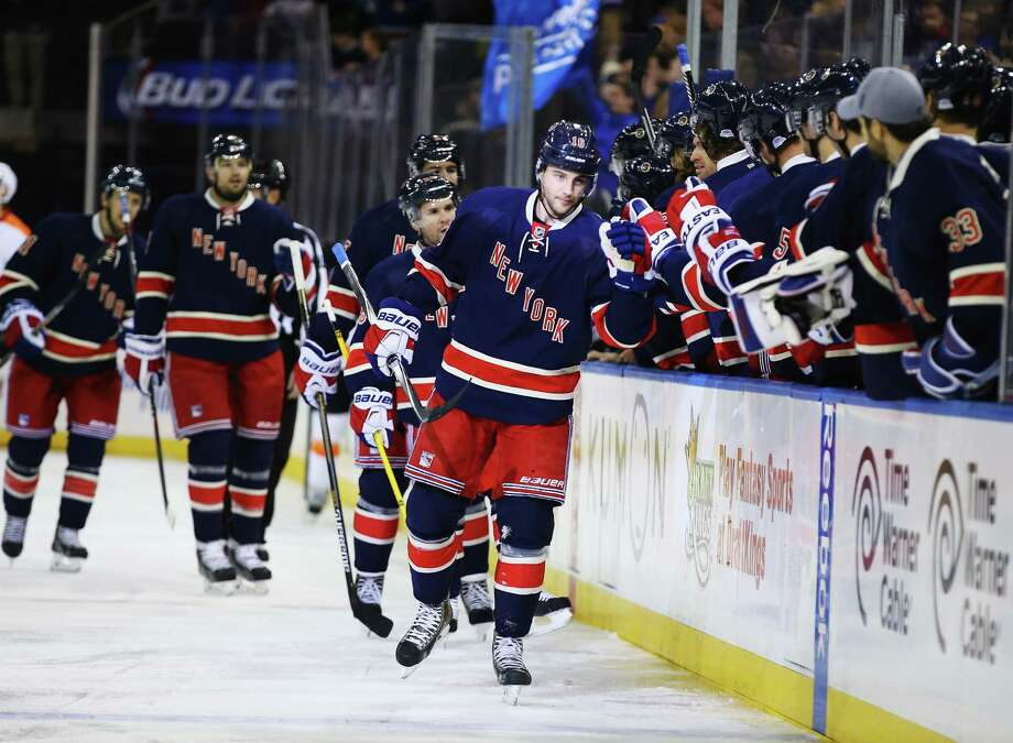Derick Brassard celebrates his goal with his Rangers teammates at Madison Square Garden on Saturday. Photo: Al Bello / Getty Images / 2014 Getty Images
