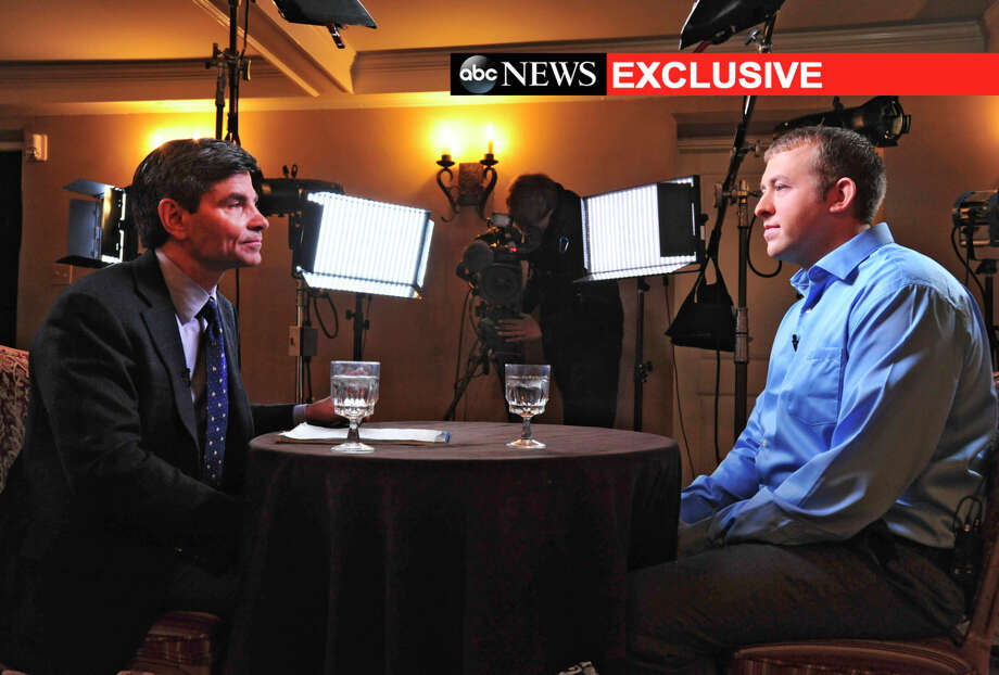 ABC News anchor George Stephanopoulos (left) interviews Officer Darren Wilson last week. Wilson, who was not indicted by a grand jury, has resigned from the Ferguson police force. Photo: Kevin Lowder / Associated Press / ABC News