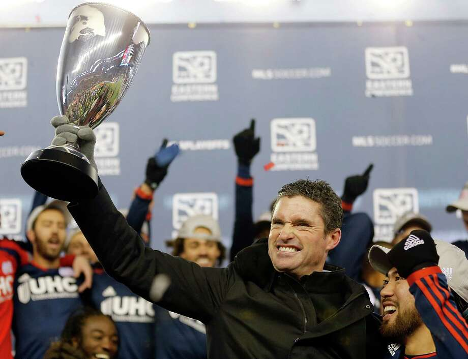 New England coach Jay Heaps holds high the Eastern Conference championship trophy. Photo: Jim Rogash / Getty Images / 2014 Getty Images