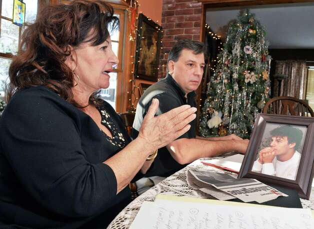 Mary Clark, left, and her son Jerry Clark with a photograph of Jerry's son (also named Jerry) who committed suicide in 2010 at age 17, during an interview Friday Nov. 28, 2014, in Voorheesville, NY.  (John Carl D'Annibale / Times Union) Photo: John Carl D'Annibale / 00029659A