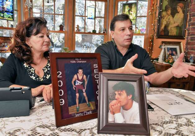 Mary Clark, left, and her son Jerry Clark with a photographs of Jerry's son (also named Jerry) who committed suicide in 2010 at age 17, during an interview Friday Nov. 28, 2014, in Voorheesville, NY.  (John Carl D'Annibale / Times Union) Photo: John Carl D'Annibale / 00029659A