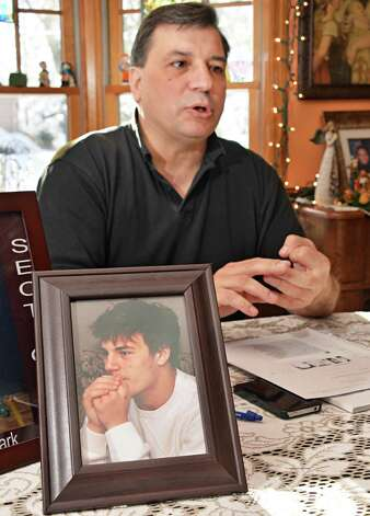 Jerry Clark with a photograph of his son (also named Jerry) who committed suicide in 2010 at age 17, during an interview Friday Nov. 28, 2014, in Voorheesville, NY.  (John Carl D'Annibale / Times Union) Photo: John Carl D'Annibale / 00029659A