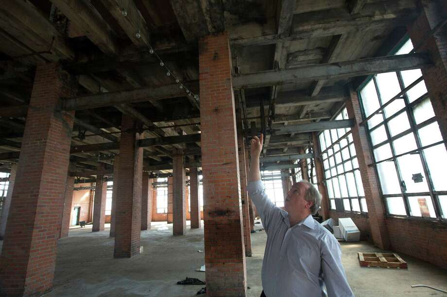 Dennis Parmer, executive director of the Sugar Land Heritage Foundation said he would love to see a boutique hotel occupy the Imperial Sugar char house. Photo: Johnny Hanson, Houston Chronicle / © 2014  Houston Chronicle