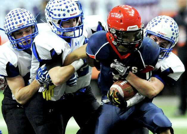 Hoosick Falls' defense works to bring down Chenango Forks' Isaiah Roman during their Class C state football final on Saturday Nov. 29, 2014, at the Carrier Dome in Syracuse, N.Y. (Cindy Schultz / Times Union) Photo: Cindy Schultz / 00029661A