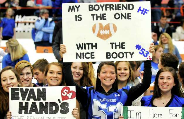 Rachel Pine, 17, center, brags about her boyfriend, football player Shayne Richard, as she joins Hoosick Falls' students for their Class C state football final against Chenango Forks on Saturday Nov. 29, 2014, at the Carrier Dome in Syracuse, N.Y. (Cindy Schultz / Times Union) Photo: Cindy Schultz / 00029661A