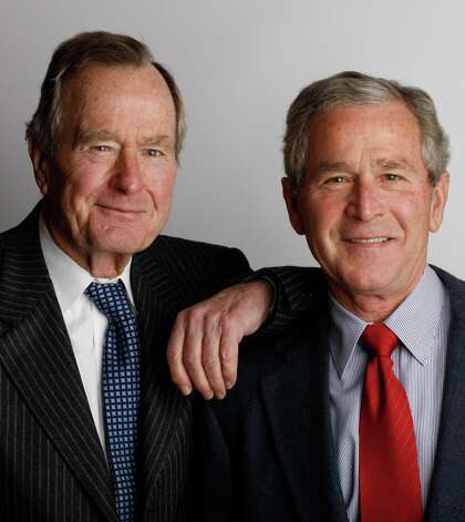 Former Presidents George H.W. Bush, the 41st, left, and George W. Bush, the 43rd, pose for a father-son portrait during the 2008 Easter holiday at Camp David in Thurmont, Md. Photo: Eric Draper